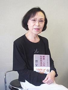 有田川水害を記録した本を手に中井さん