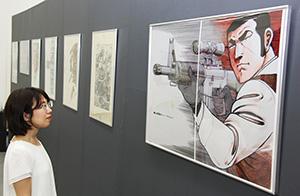 銃を構える『ゴルゴ13』のおなじみのポスター